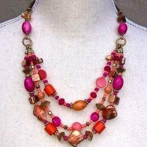 Multi strand pink and coral colored necklace